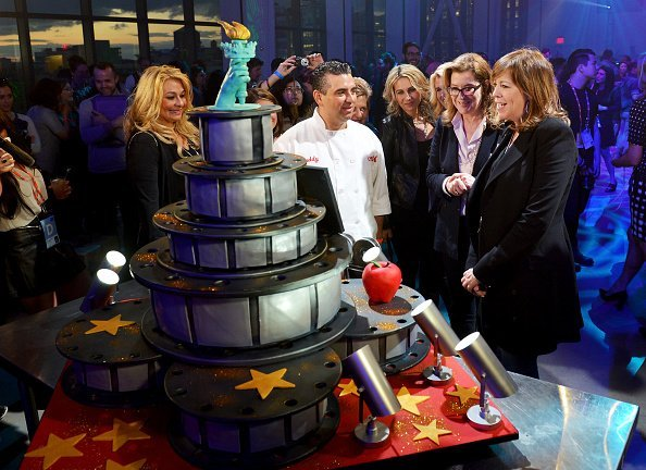 Buddy Valastro, Tribeca Film Festival Executive Vice President Paula Weinstein, and Tribeca Film Festival Co-founder Jane Rosenthal at the Filmmaker Welcome Party during the 2015 Tribeca Film Festival at Spring Studios on April 17, 2015, in New York City. | Source: Getty Images.