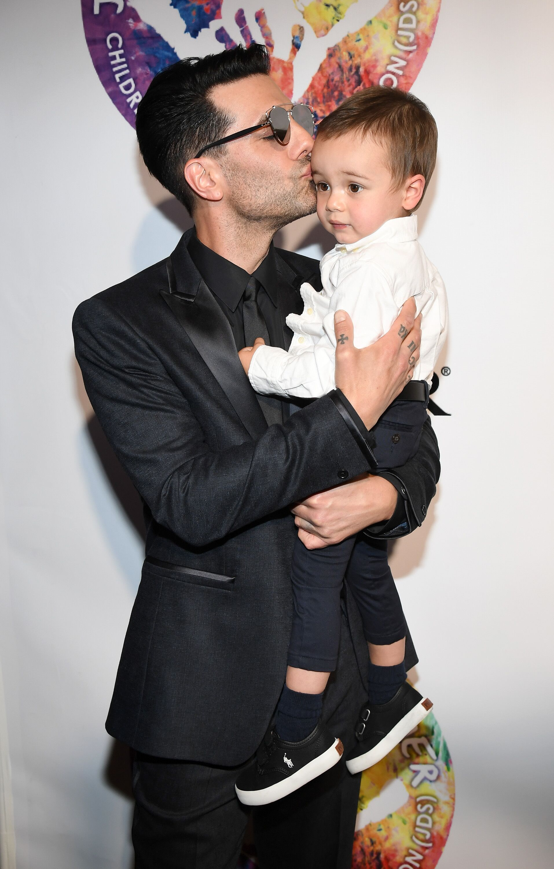 Criss Angel with his son Johnny Crisstopher at Criss Angel's HELP (Heal Every Life Possible) charity event in Las Vegas in 2016 | Source: Getty Images