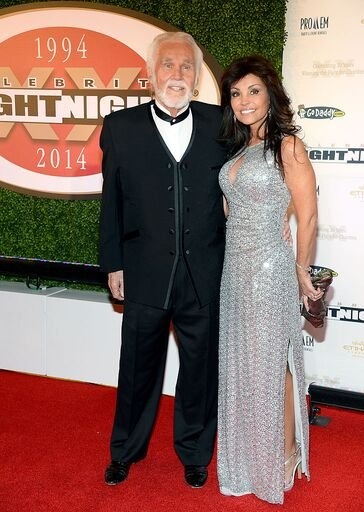 Kenny Rogers and Wanda Miller at Muhammad Ali's Celebrity Fight Night XX held at the JW Marriott Desert Ridge Resort & Spa on April 12, 2014 in Phoenix, Arizona. . | Source: Getty Images