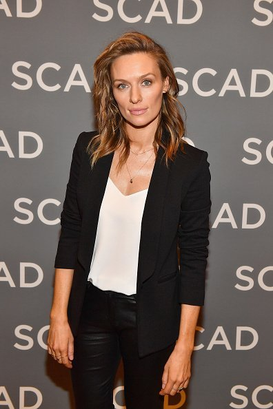 "Michaela McManus attends ""The Village"" press junket during SCAD aTVfest 2019 at Four Seasons Hotel on February 9, 2019, in Atlanta, Georgia. 