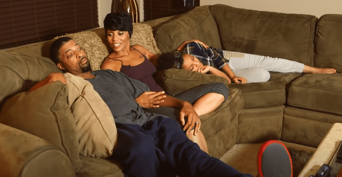 A screenshot of singer Adina Howard with her husband and daughter | Photo: YouTube/ BET Her
