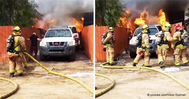 Valiente hombre aparta a bomberos y arriesga su propia vida para salvar a su perrito de incendio