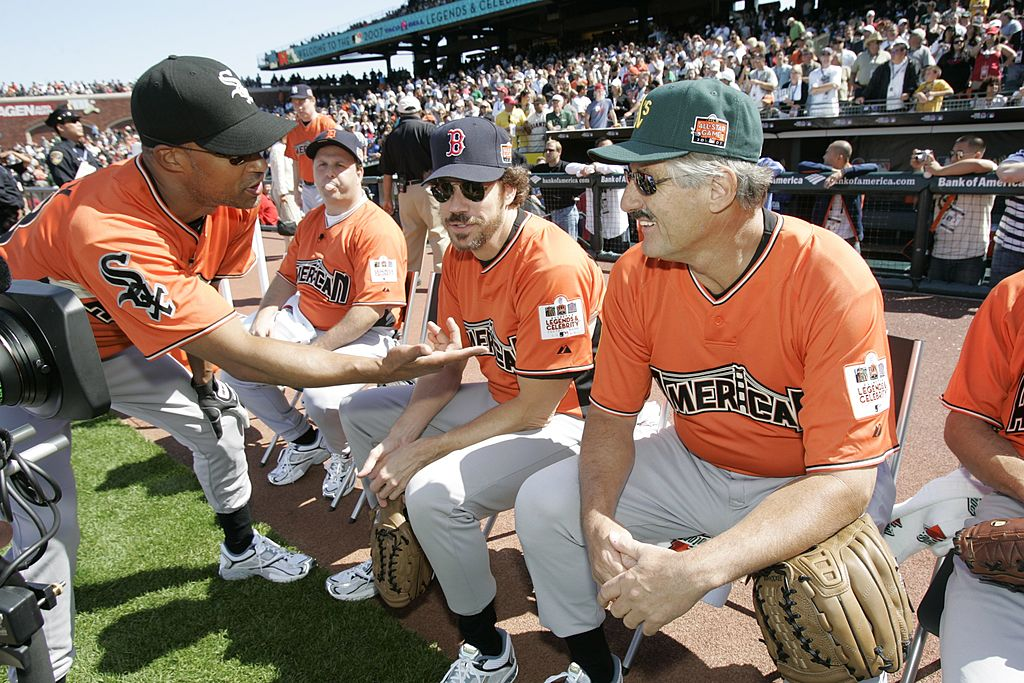 Jon Kelley of the American League Legends talks with Marcus Giamatti and Rollie Fingers during the Taco Bell All-Star Legends & Celebrity Softball Game  | Getty Images