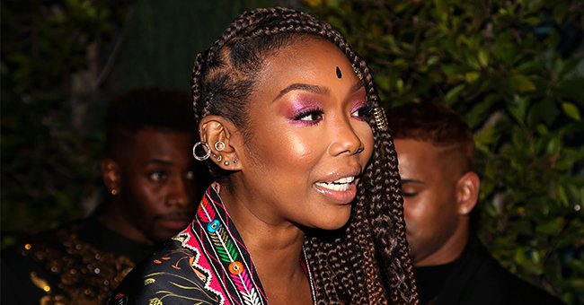 Brandy's Only Daughter Sy'Rai Poses in a Sheer Dress Showing Her Likeness to Mom