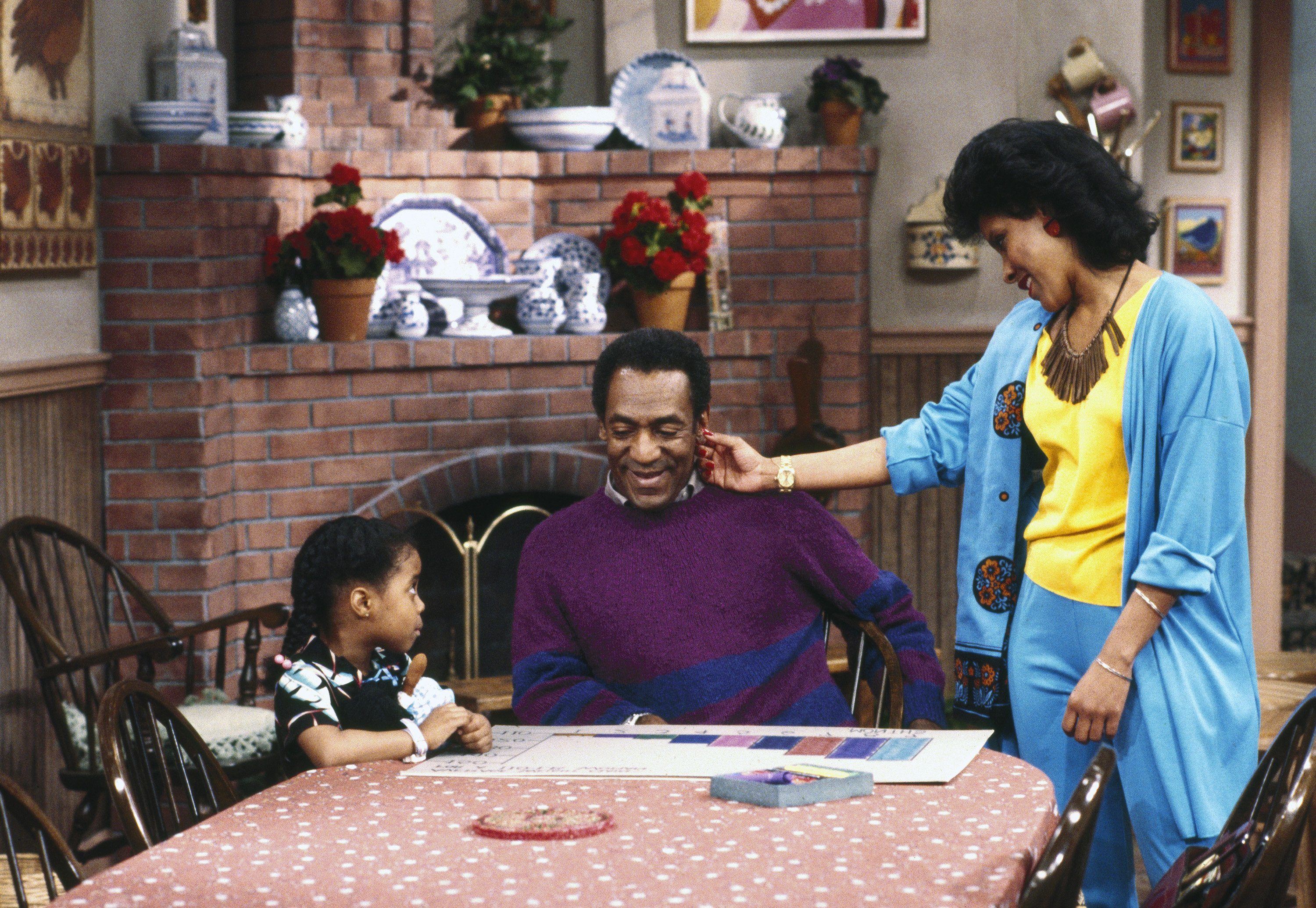 """Keshia Knight Pulliam as Rudy Huxtable, Bill Cosby as Dr. Heathcliff 'Cliff' Huxtable, Phylicia Rashad as Clair Hanks Huxtable """"The Cosby Show"""" 