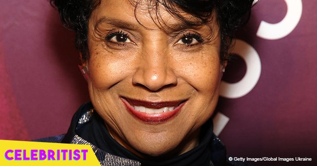 Phylicia Rashad's only daughter turns heads in red off-shoulder dress in rare photo with father