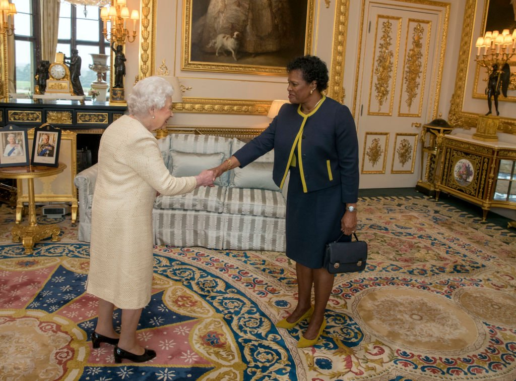 Queen Elizabeth II receives Governor-General of Barbados Dame Sandra Mason during a private audience at Buckingham Palace on March 28, 2018 in London, England. | Photo: Getty Images.