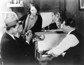 "Still from the opening scene of ""Black and Tan"" featuring Fredi Washington and Duke Ellington 