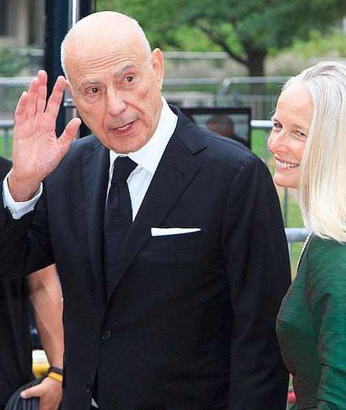 Alan Arkin waves beside his wife Suzanne Newlander at the 2012 Toronto International Film Festival. | Source: Wikimedia Commons