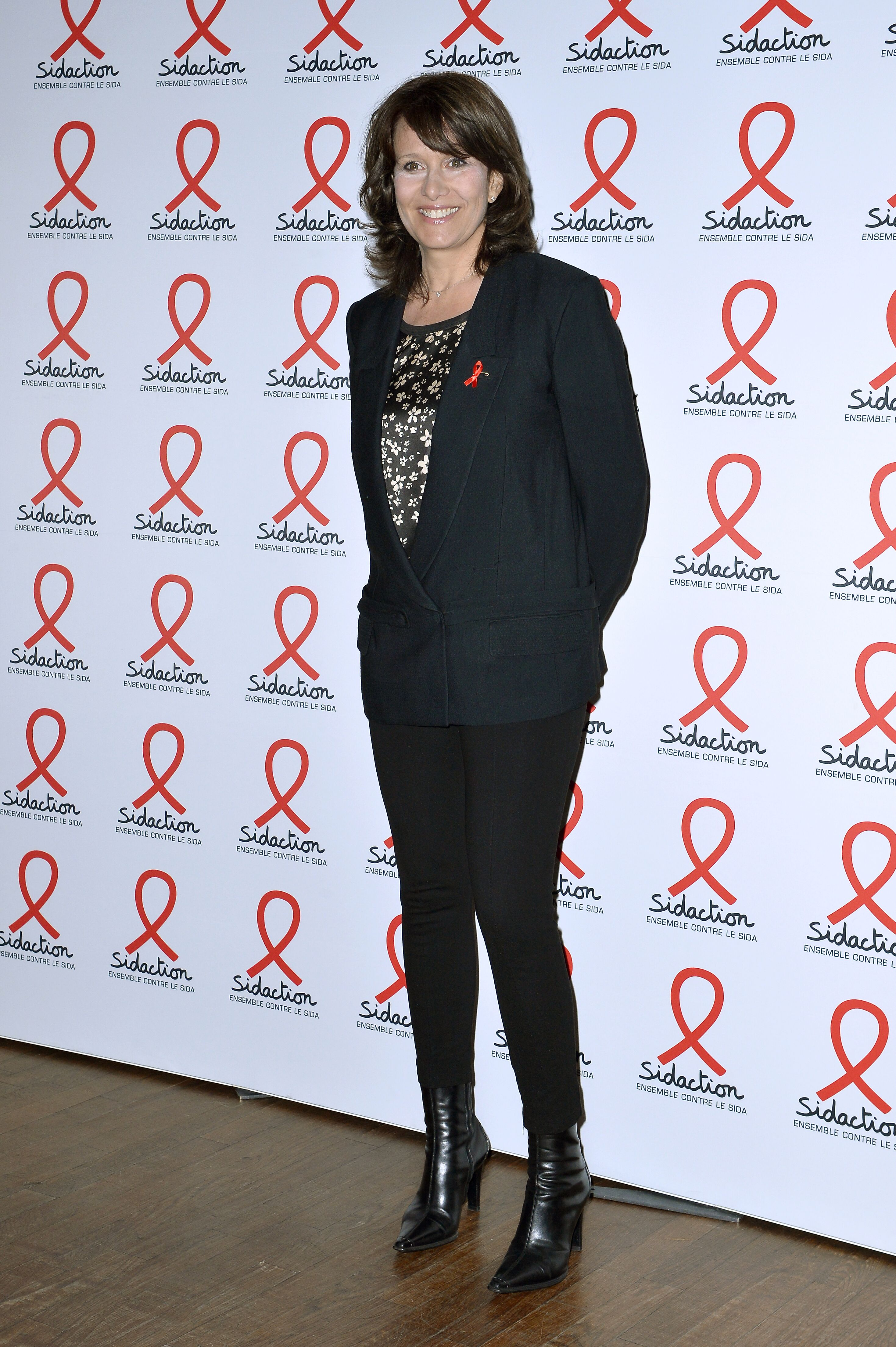 Carole Rousseau assiste au photocall de Sidaction 2019 à la Salle Wagram le 18 mars 2019 à Paris, France. | Photo : Getty Images