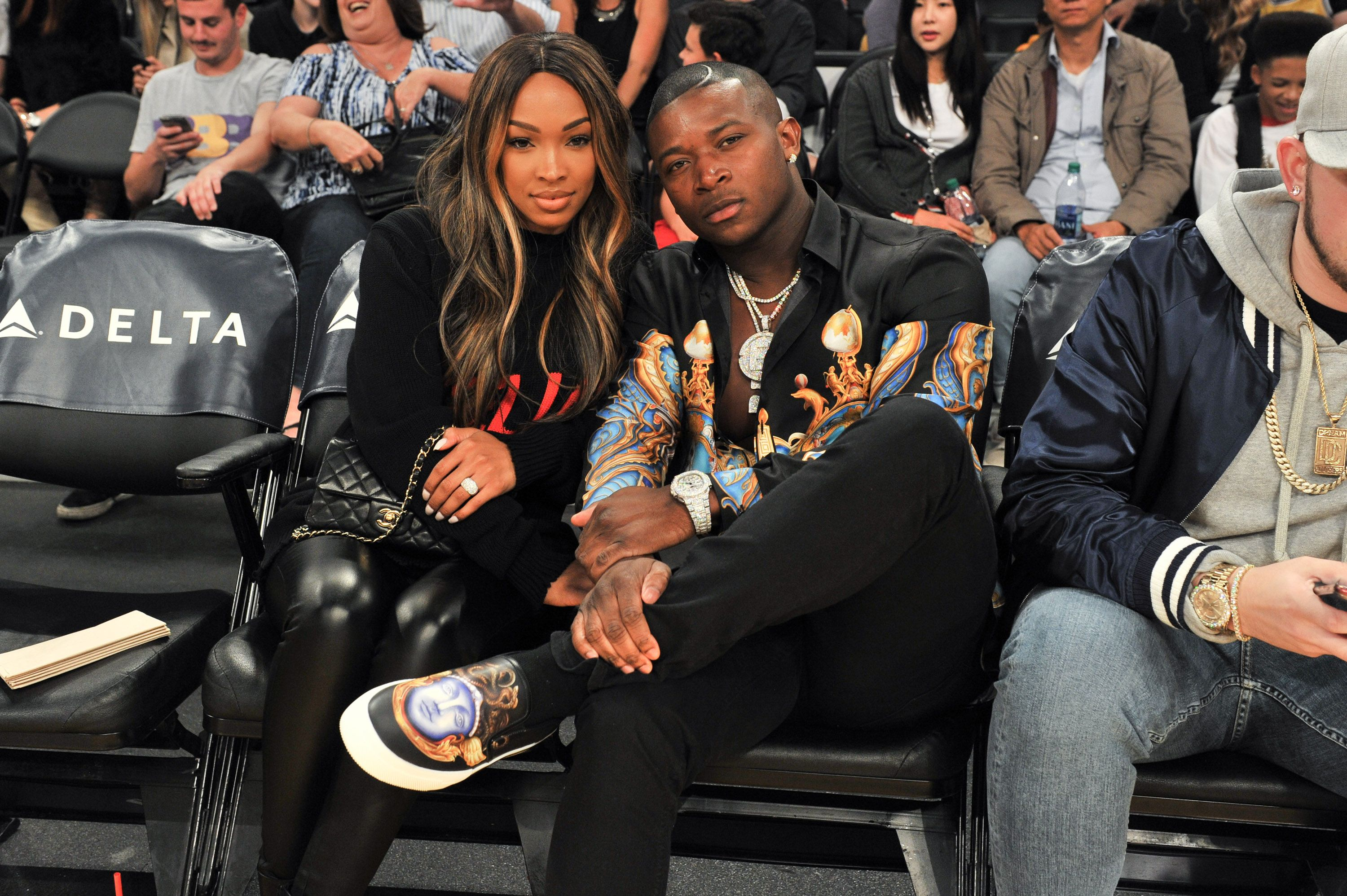 Malika Haqq and O.T. Genasis during a basketball game on November 21, 2017 in California. | Source: Getty Images