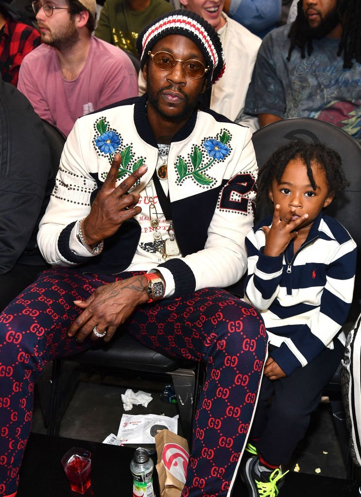 2 Chainz and his only son, Halo watching an NBA game in November 2018. | Photo: Getty Images
