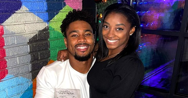 Simone Biles & Jonathan Owens Pack on the PDA as They Share a Kiss Wearing Matching Outfits