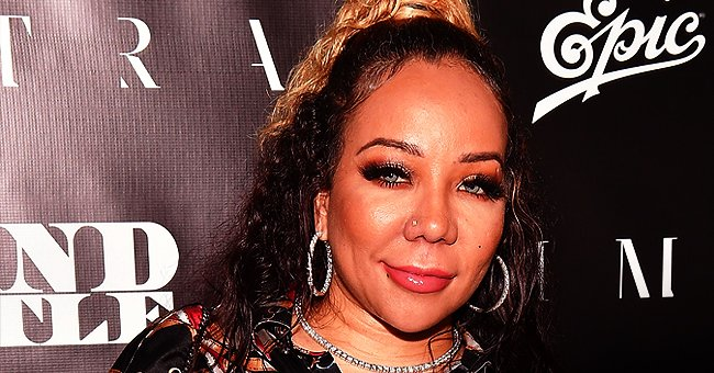 Tiny Harris Looks Stunning in Leather Pants and over the Knee Boots after Joining Husband TI at His 'Red Table Talk' Interview