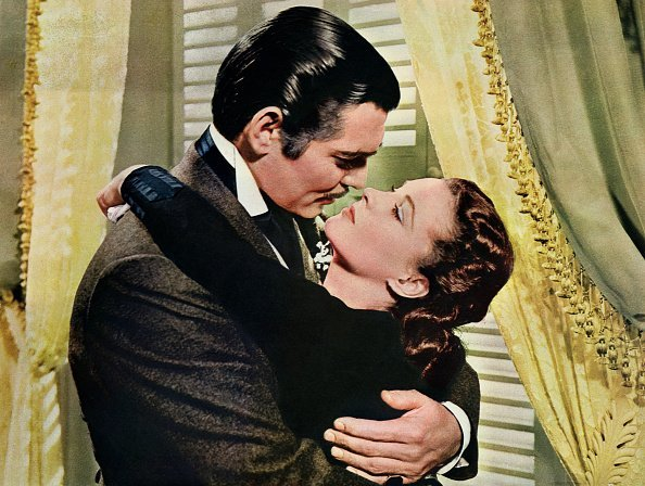 Rhett Butler (Clark Gable) embraces Scarlett O'Hara (Vivien Leigh) in a famous scene from the 1939 epic film Gone with the Wind | Photo: Getty Images