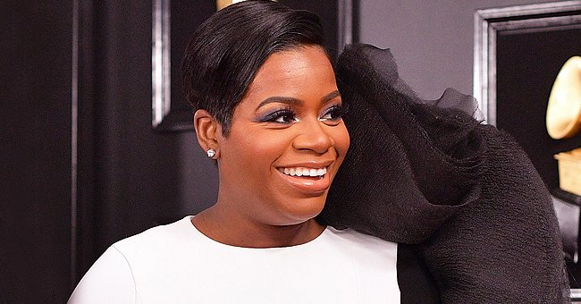 Fantasia Stuns on a Night Out with Her Bestie in a Black Jumpsuit with a Red Bag (Video)