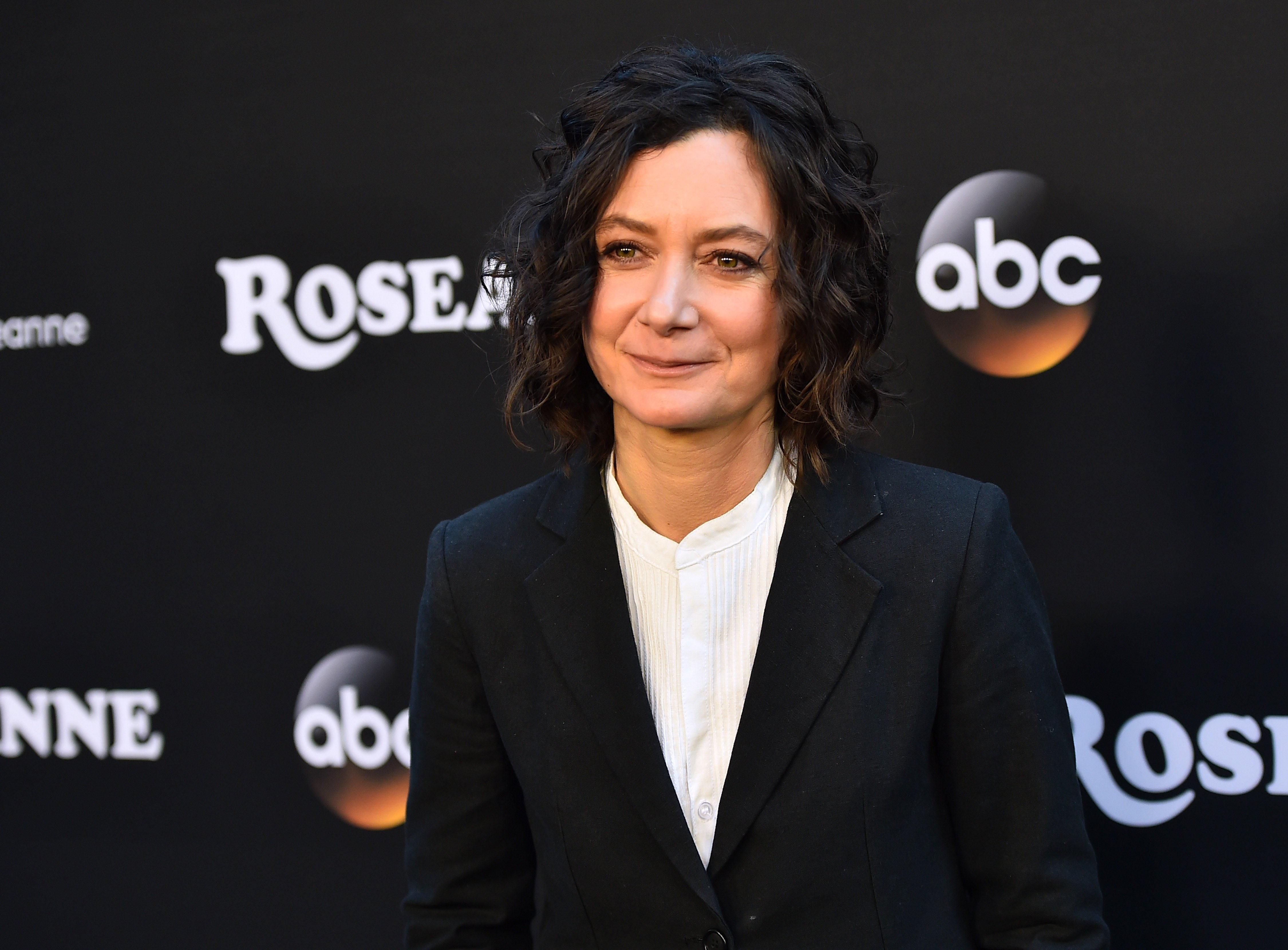 """Sara Gilbert attends the premiere of """"Roseanne"""" at Burbank, California on March 23, 2018 