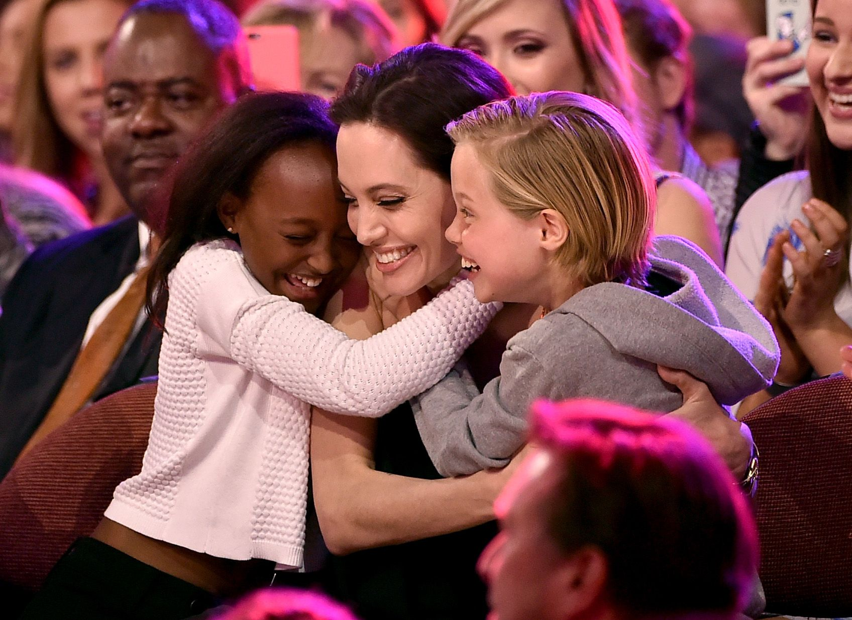 Angelina Jolie hugs Zahara Marley Jolie-Pitt and Shiloh Nouvel Jolie-Pitt after winning award for Favorite Villain in 'Maleficent' during Nickelodeon's 28th Annual Kids' Choice Awards on March 28, 2015 | Photo: Getty Images