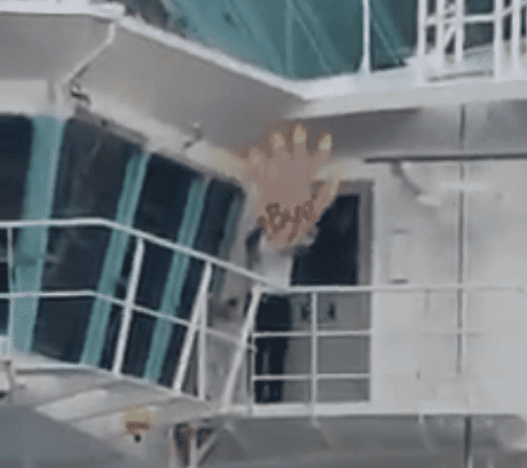Freedom of the Seas Cruise Ship crew member waves goodbye with a giant fake hand   Photo: Facebook/Cruceros Puerto Rico