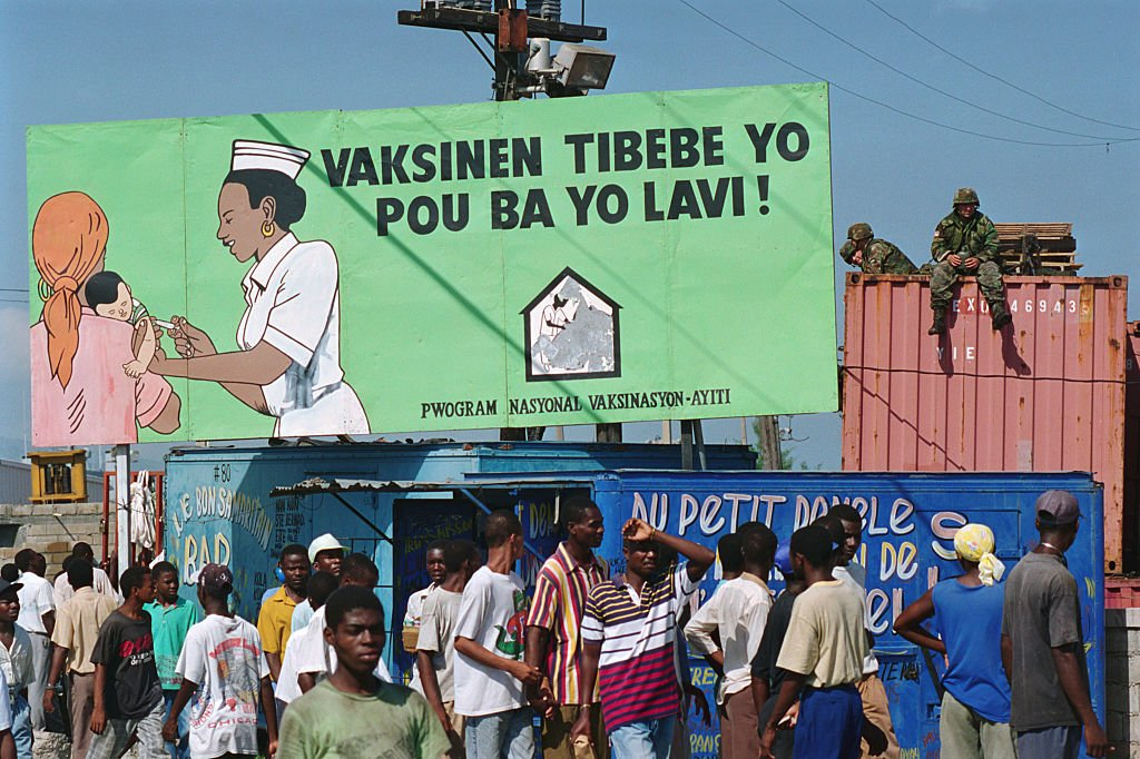 Sign encouraging the vaccination of children, Haiti, circa 1990s   Source: Getty Images
