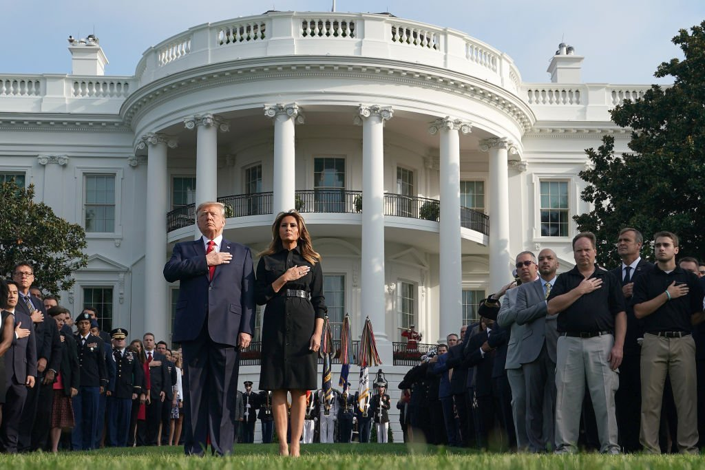 President Donald Trump and first lady Melania Trump as they participate in a moment of silence at the South Lawn of the White House. Source: Getty Images
