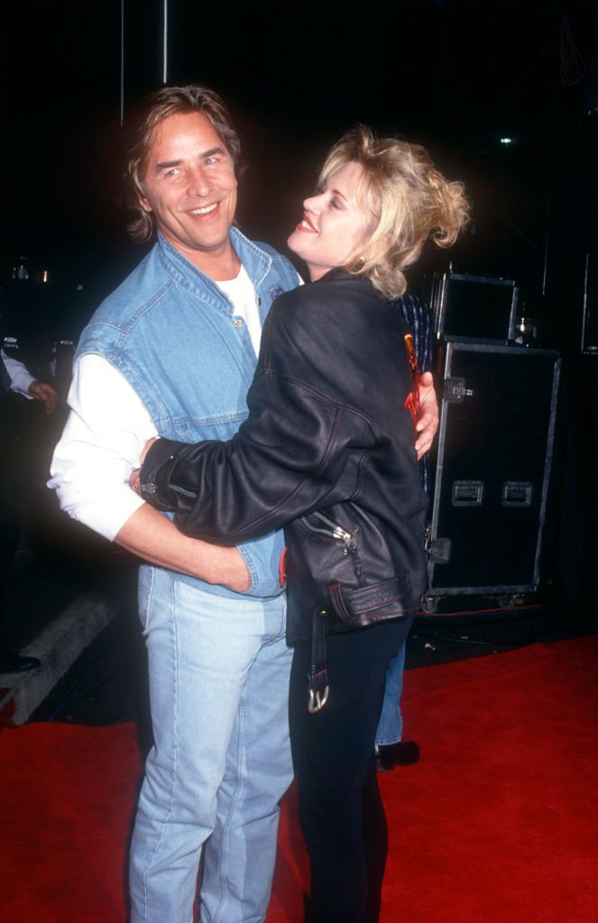 Actor Don Johnson and wife actress Melanie Griffith arrive for the grand opening of Planet Hollywood on March 22, 1994 in Phoenix, Arizona. | Source: Getty Images