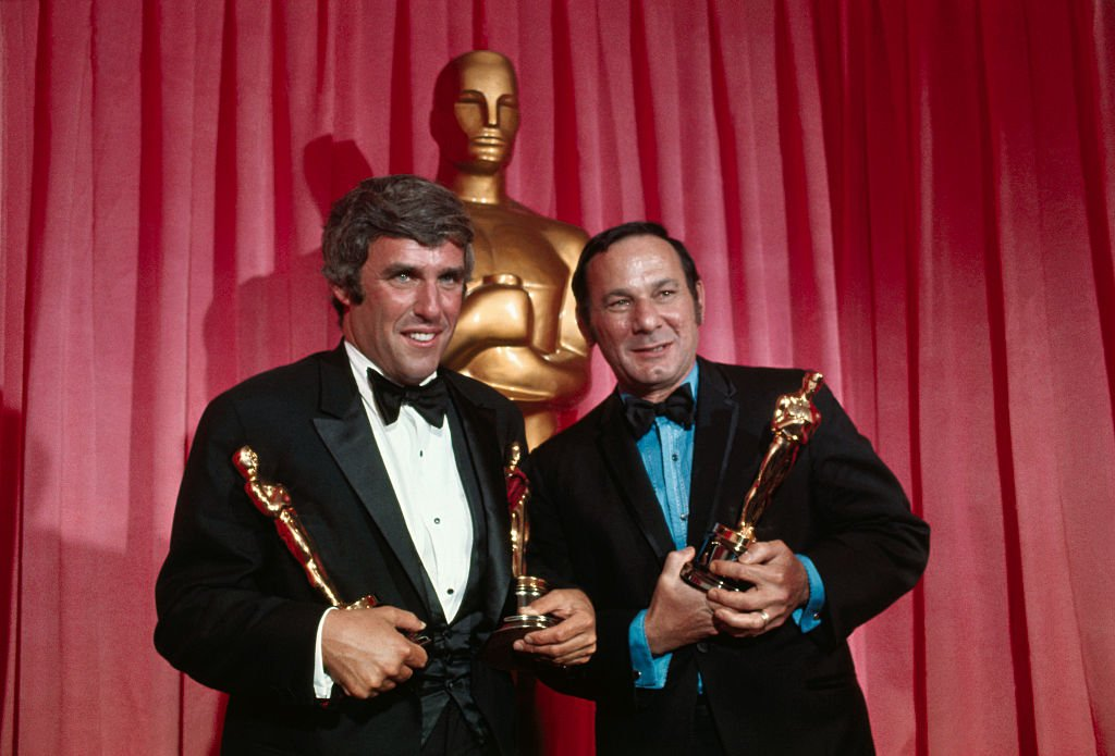 """For """"Best Song in a Movie"""" for 1969, composer Burt Bacharach (left) and lyricist Hal David hold Oscars they won for """"Raindrops Keep Falling on my Head"""" from """"Butch Cassidy and the Sundance Kid,"""" at the Academy Awards.   Source: Getty Images"""
