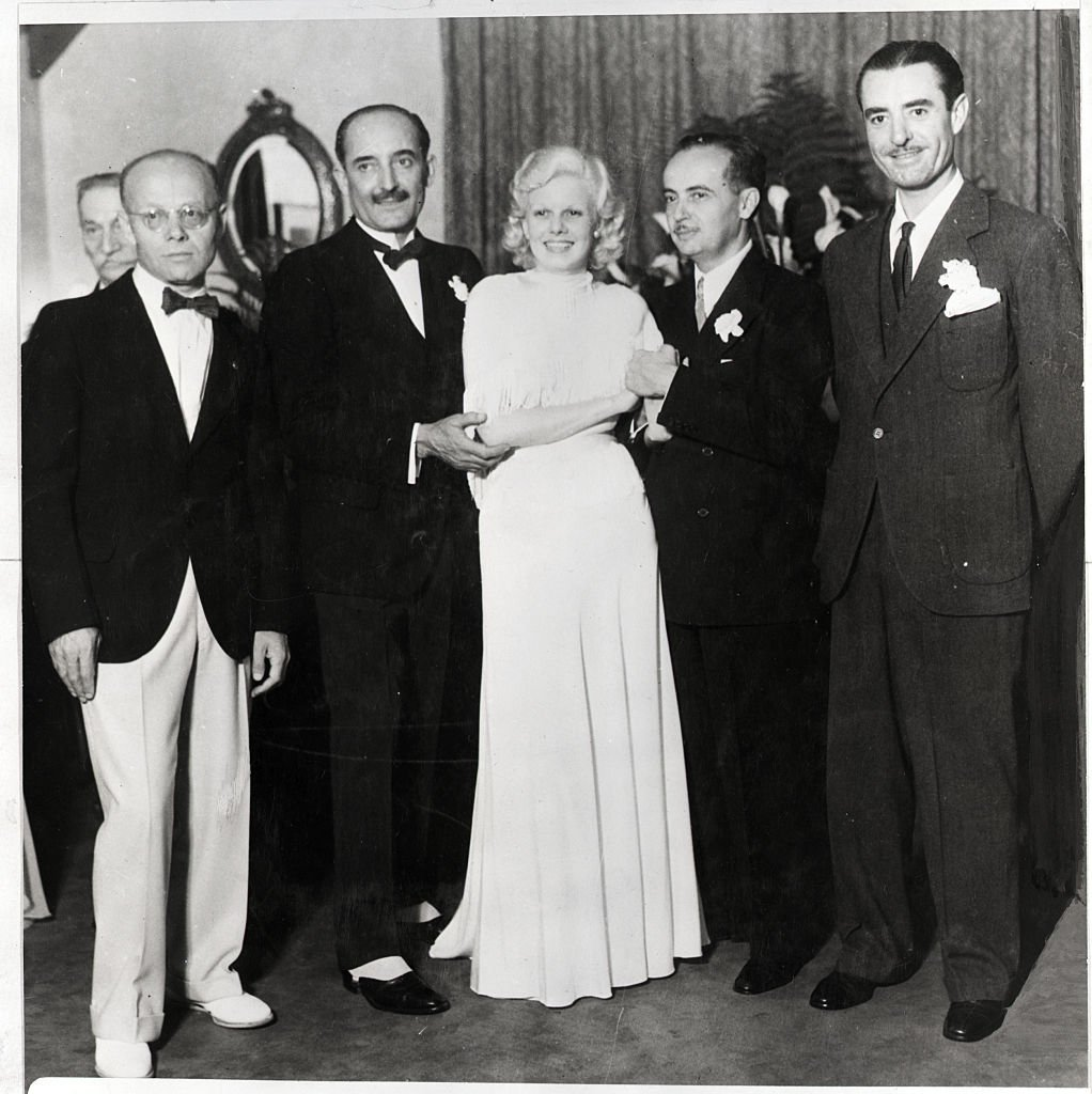 Jean Harlow at marriage to Paul Bern, film executive, 1932 with stepfather Count Bello and best man, John Gilbert. | Source: Getty Images