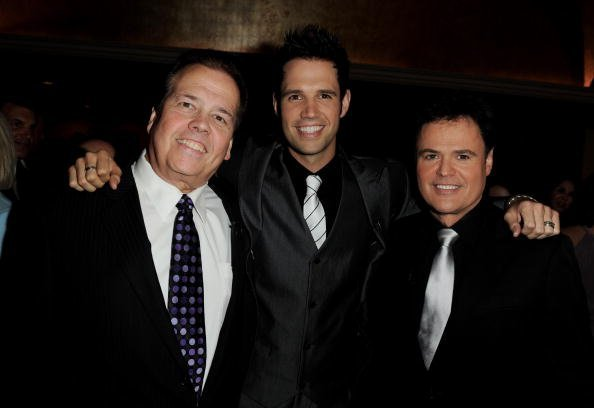 Singers Alan Osmond, his son David Osmond and Alan's brother Donny Osmond arrive at The National Multiple Sclerosis Society's 36th Annual Dinner Of Champions at the Century Plaza Hotel on September 27, 2010, in Los Angeles, California. | Source: Getty Images.