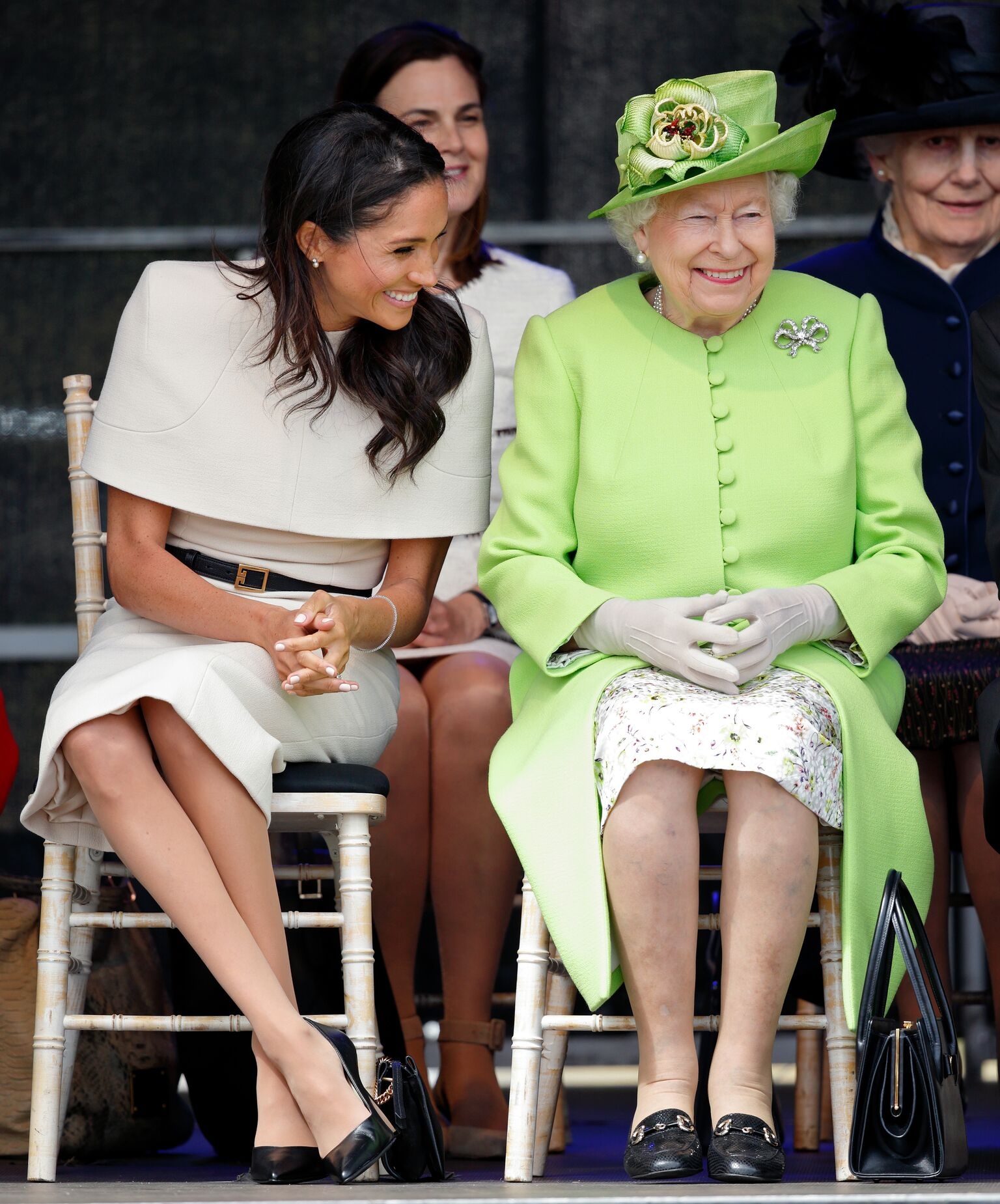 Meghan, Duchess of Sussex and Queen Elizabeth II attend a ceremony to open the new Mersey Gateway Bridge | Getty Images / Global Images Ukraine