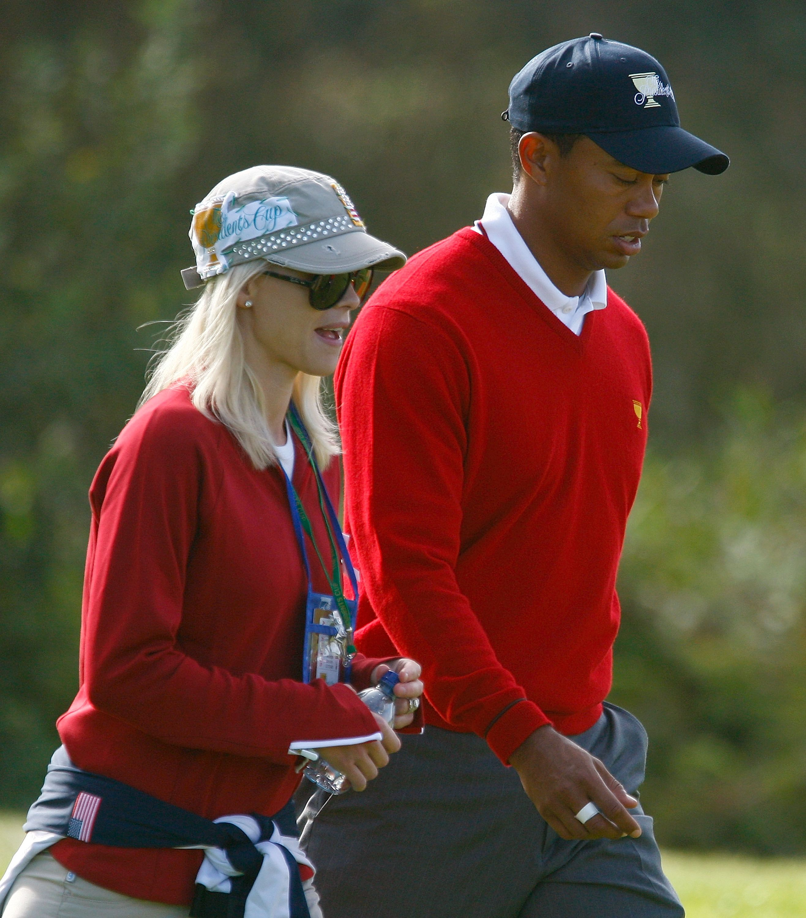 Tiger Woods and Elin Nordegren during the Day One Foursome Matches of The Presidents Cup at Harding Park Golf Course on October 8, 2009 in San Francisco, California. | Source: Getty Imags