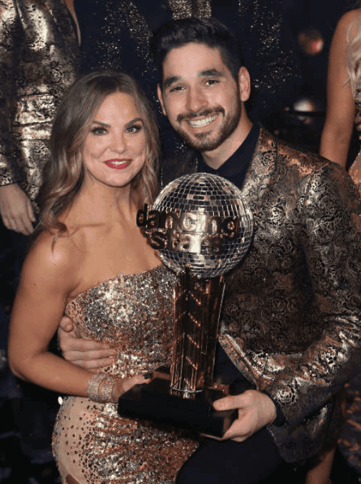 """Hannah Brown and Alan Bersten backstage, holding the mirror ball after their win, at """"Dancing with the Stars"""" Season 28 Finale, on November 25, 2019, in Los Angeles, California 