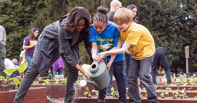 Michelle Obama Shares a Photo Watering Plants with Children in Honor of National Gardening Day