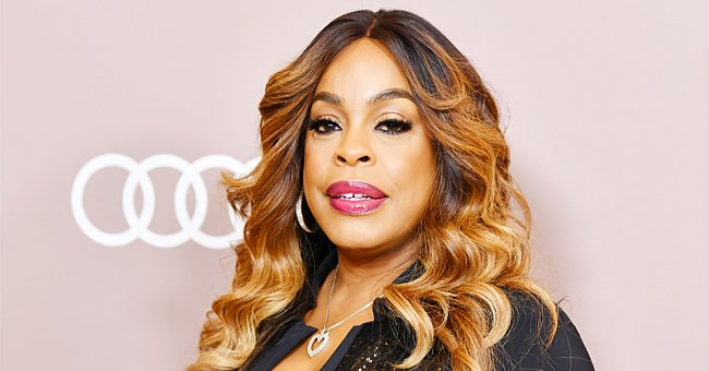 Niecy Nash Looks Unforgettable in Pink Silk Suit with a Deep Neckline and Sparkling Accessories