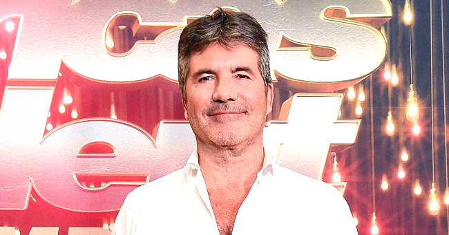 Simon Cowell Sticks out His Tongue in an Adorable New Photo with His Son and Judges
