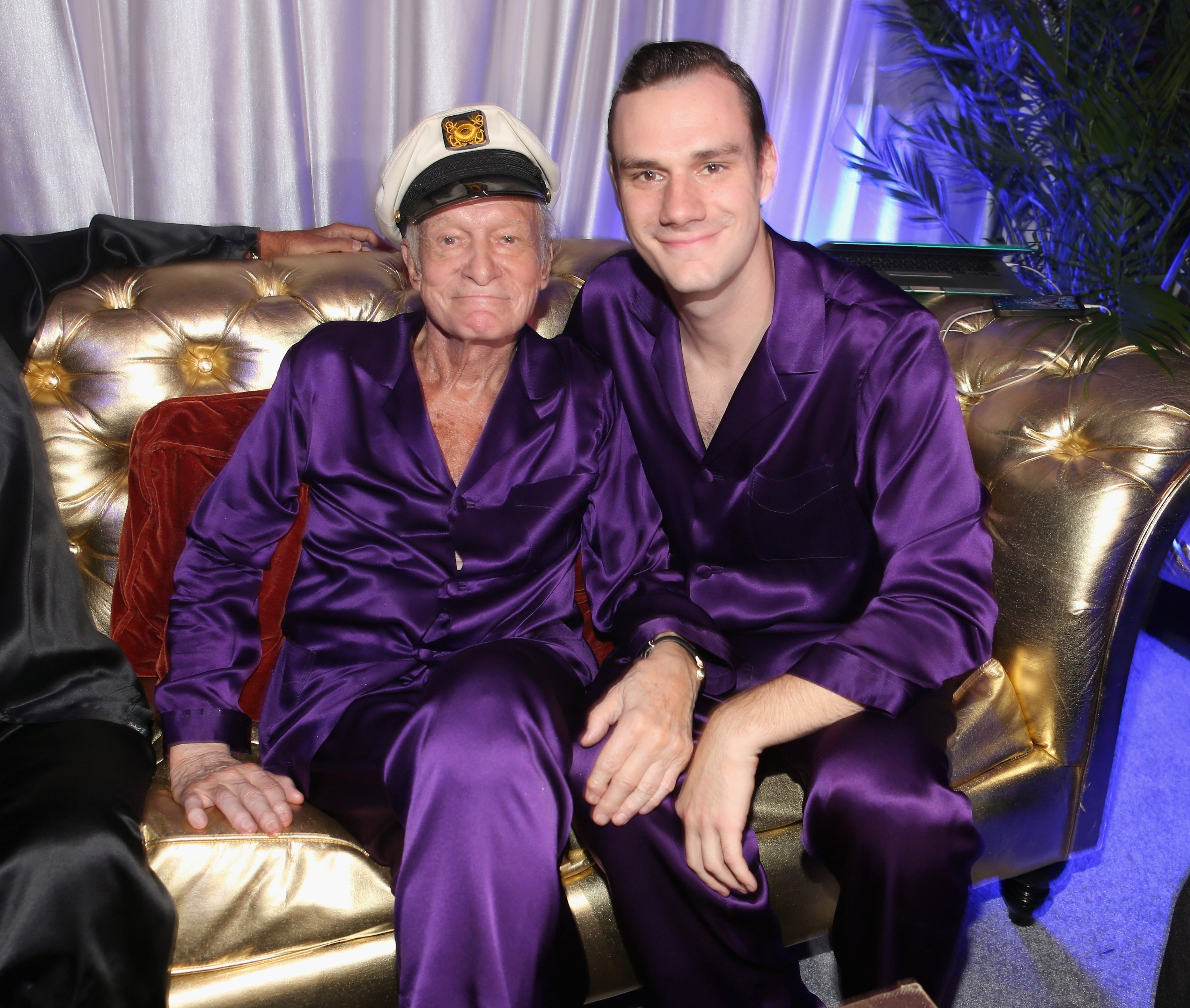 Hugh Hefner and Cooper Hefner attend the Annual Midsummer Night's Dream Party at the Playboy Mansion on August 16, 2014, in Holmby Hills, California. | Source: Getty Images.