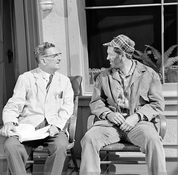 "Howard McNear as barber Floyd Lawson and George Lindsey as Goober in a scene from the television series ""The Andy Griffith Show,"" circa 1966. 