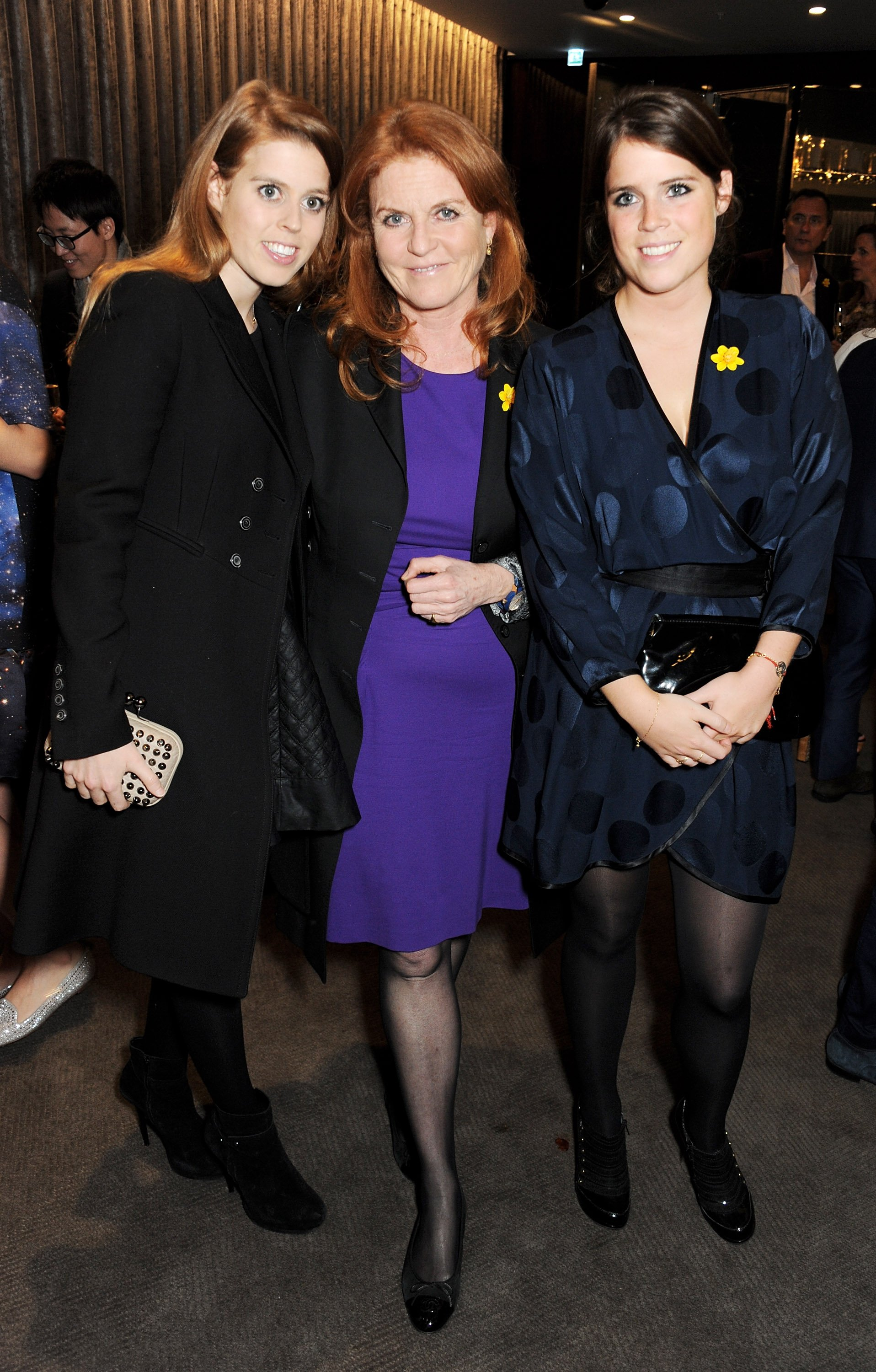 Princess Beatrice, Sarah Ferguson, and Princess Eugenie of York attend a charity auction for the Samsung NX Camera launch in London, England on May 14, 2013 | Photo: Getty Images