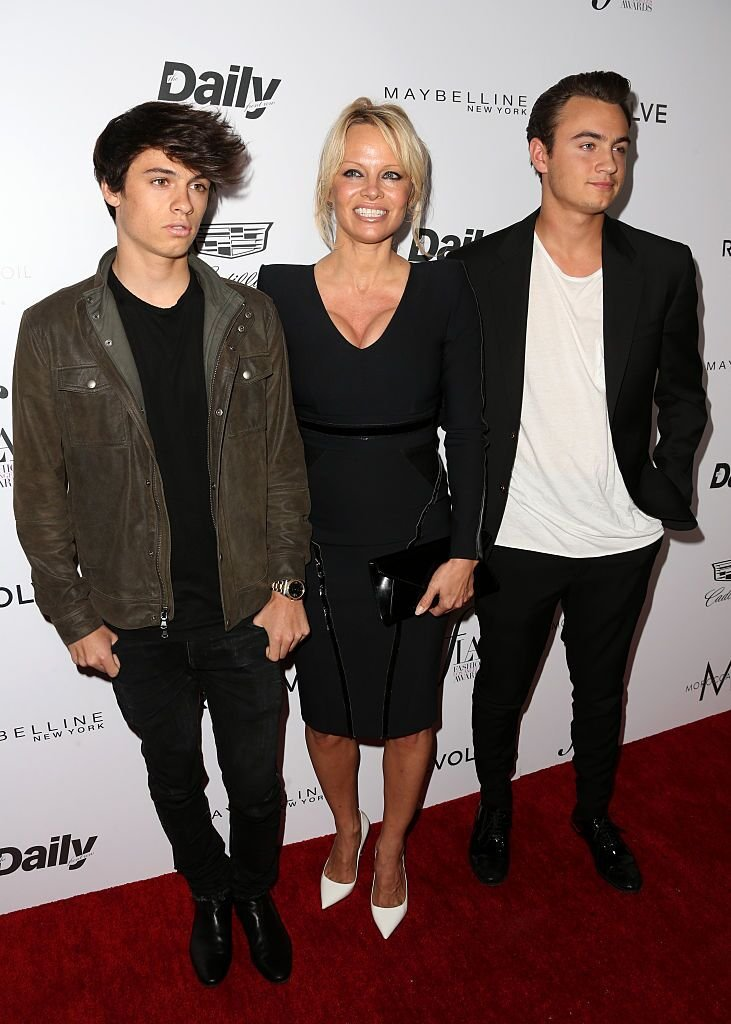 """Pamela Anderson and her sons Brandon Thomas Lee (R) and Dylan Jagger Lee at the """"Fashion Los Angeles Awards"""" on March 20, 2016, in West Hollywood, California 
