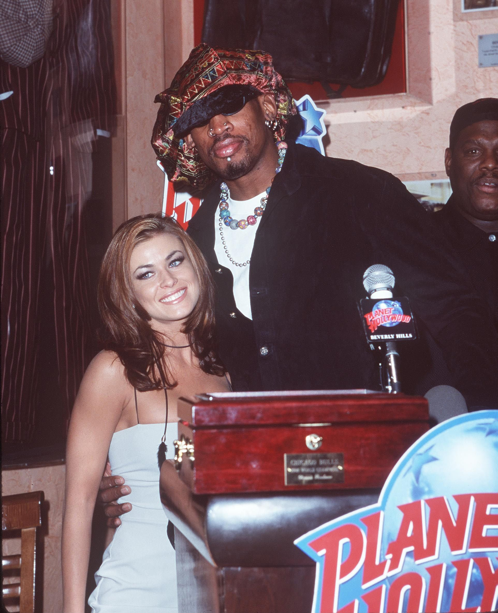 Dennis Rodman and Carmel Electra during a press conference at Planet Hollywood in Beverly Hills, California. | Source: Getty Images