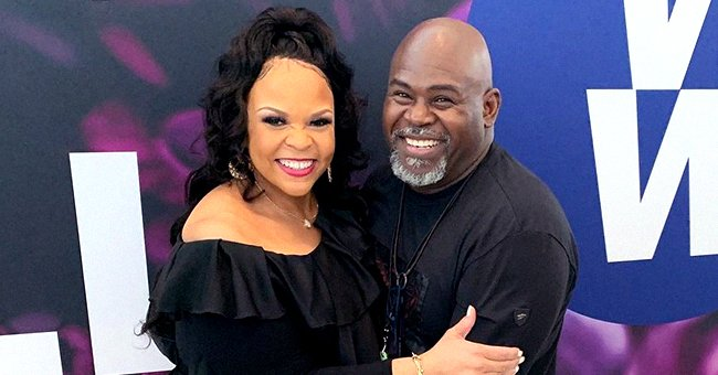 Tamela Mann Stuns in Navy Blue Wrinkle Dress Posing With Husband David in Matching Suit on Stairs