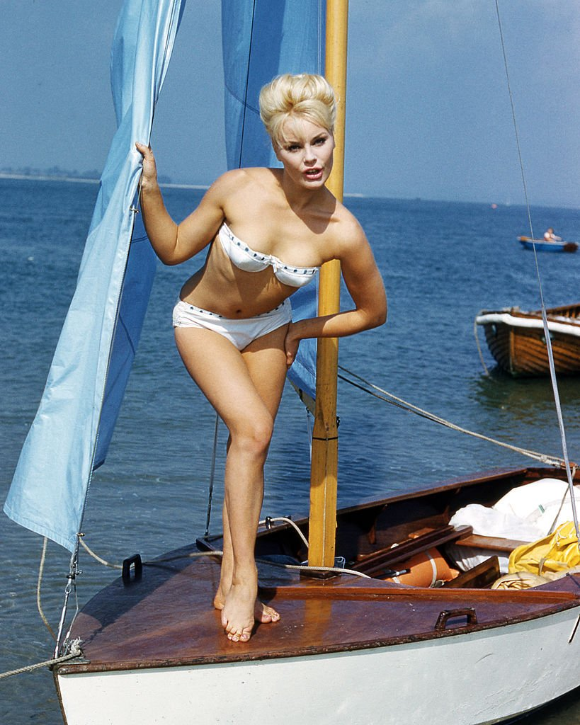 German actress Elke Sommer wearing a bikini and standing on the deck of a sailing dinghy, circa 1963. (Photo by Silver Screen Collection/Getty Images)