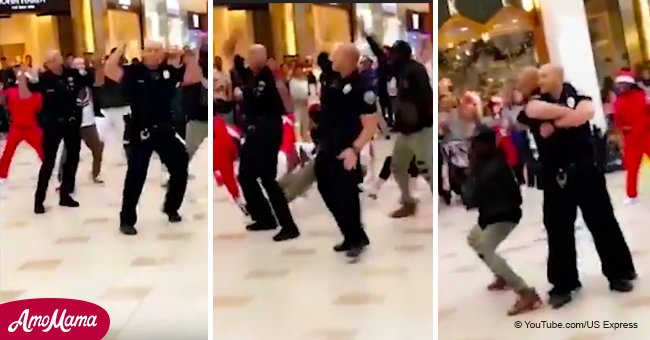 Two cops steal the spotlight in a Christmas flash mob