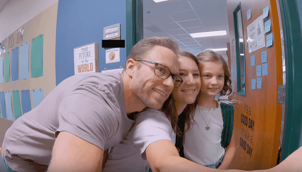 Adam, Danielle, and Blayke Busby taking a selfie at a school. | Photo: YouTube/It's a Buzz World