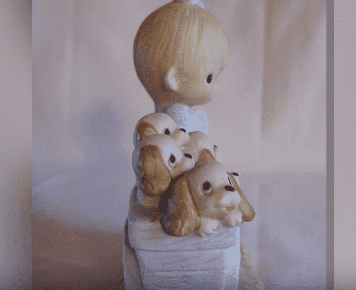 """The original 21 Precious Moments figurine released in 1979, """"God Loveth a Cheerful Giver"""" 