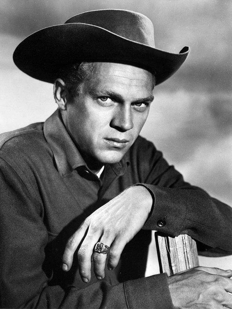 Portrait of American actor Steve McQueen (1930 - 1980) (as Josh Randall), perched atop a fence, in the television series 'Wanted: Dead or Alive,' late 1950s or early 1960s.   Source: Getty Images