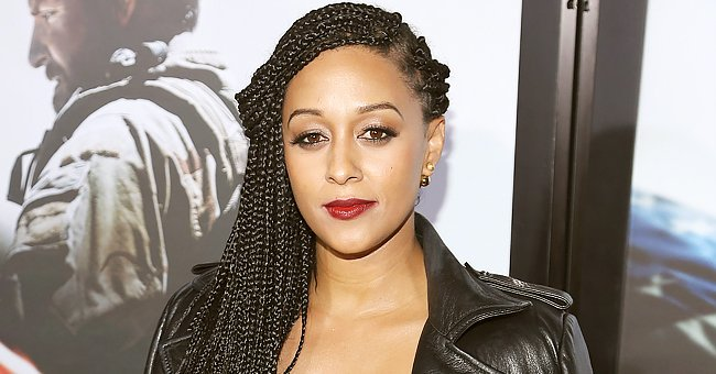 'Sister, Sister' Star Tia Mowry Turns Heads Showing Her Fit Legs in a Navy Dress & High Heels