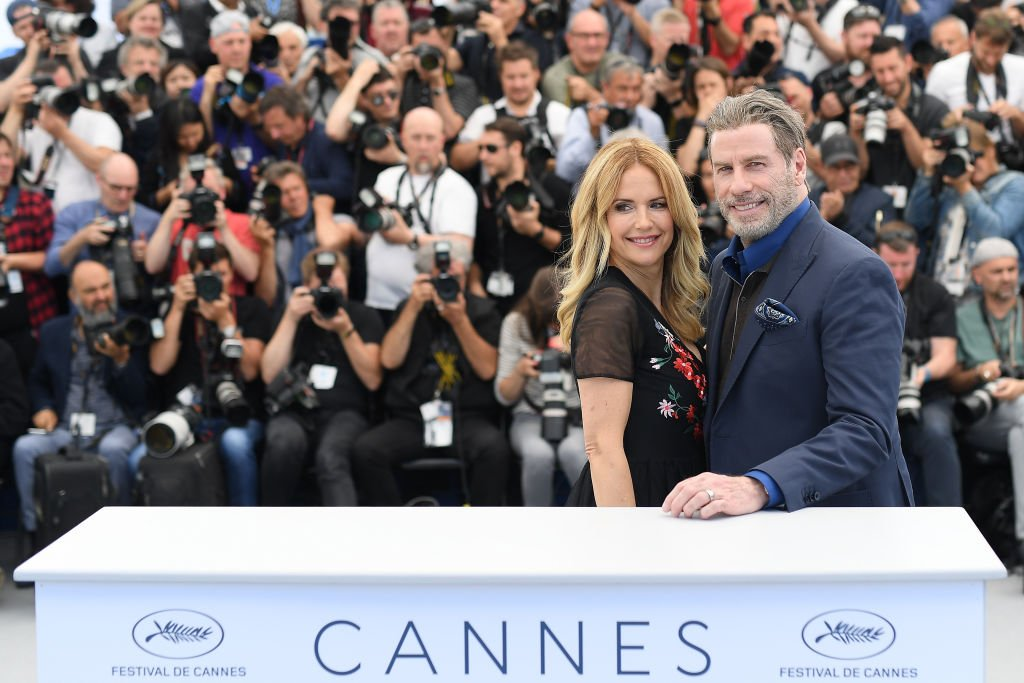 Kelly Preston and John Travolta smile at the 71st annual Cannes Film Festival at Palais des Festivals on May 15, 2018   Photo: Getty Images