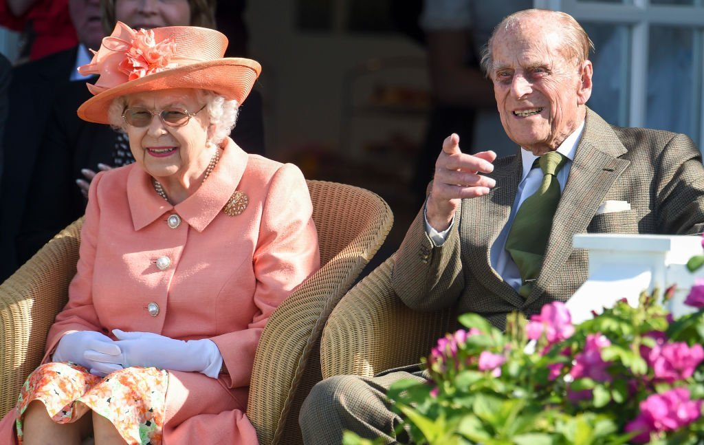 Queen Elizabeth II and Prince Philip, Duke of Edinburgh attend The Out-Sourcing Inc Royal Windsor Cup 2018 polo match on June 24, 2018 | Photo: GettyImages