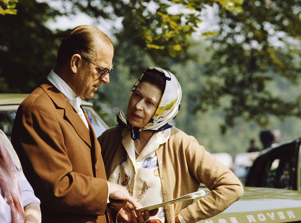Prince Philip and his wife Queen Elizabeth in conversation | Photo: Getty Images